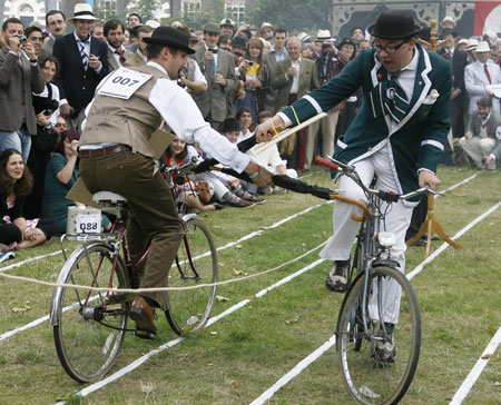 Contenders ready: Umbrellas are drawn for the bicycle jousting competition