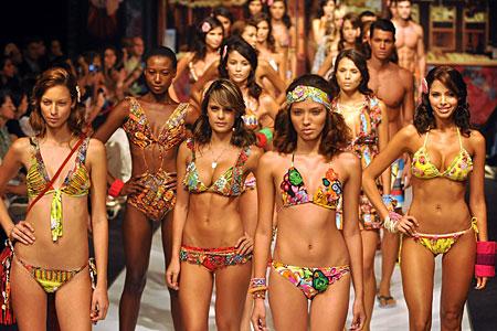 Models wear swimwear by Colombian brand Agua Bendita