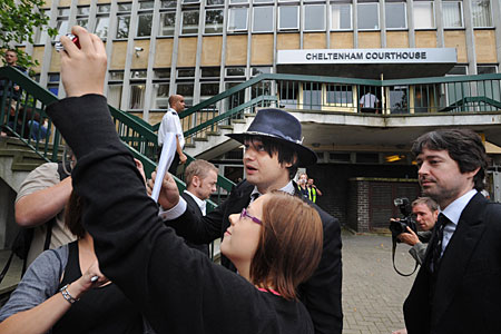 Pete Doherty grets fans outside court today