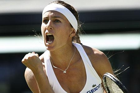 Gisela Dulko celebrates after knocking out former champion Maria Sharapova