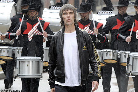 Ian Brown leads a band of drummers during the video shoot