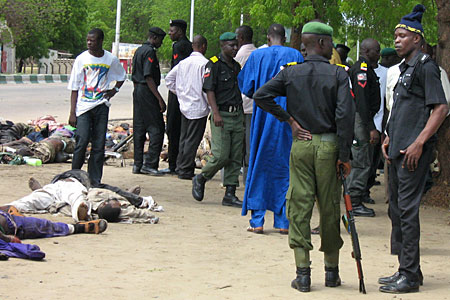 Police stand alongside bodies of dead Islamic militants in Nigeria.