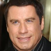 Two men have denied trying to extort money from John Travolta