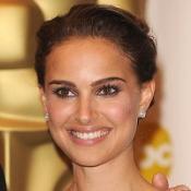 Natalie Portman has denied she is romantically involved with Sean Penn