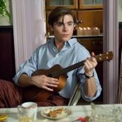 Zac Efron is pictured playing the ukulele in his new film