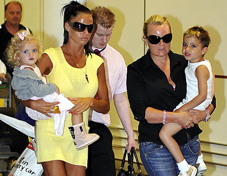 Katie Price arrives back from the Maldives with her children Princess and Junior