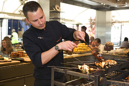 All fired up: Nic Watt throws some tasty skewers on the robata for the hungry lunch crowd at Roka