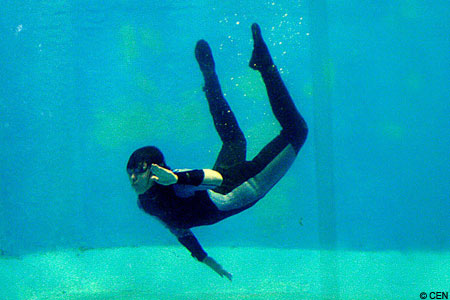 The drowning diver suffers cripping cramps and appears to float the bottom.