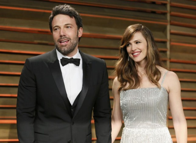 Actor Ben Affleck and his wife, actress Jennifer Garner arrive at the 2014 Vanity Fair Oscars Party in West Hollywood, California March 2, 2014. REUTERS/Danny Moloshok (UNITED STATES - Tags: ENTERTAINMENT)(OSCARS-PARTIES) Danny Moloshok/Reuters
