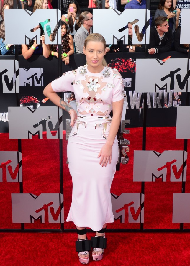 Rapper Iggy Azalea arrives on the red carpet for the 2014 MTV Movie Awards at the Nokia Theater in Los Angeles, California, on April 13, 2014. AFP PHOTO / Frederic J. BROWNFREDERIC J. BROWN/AFP/Getty Images