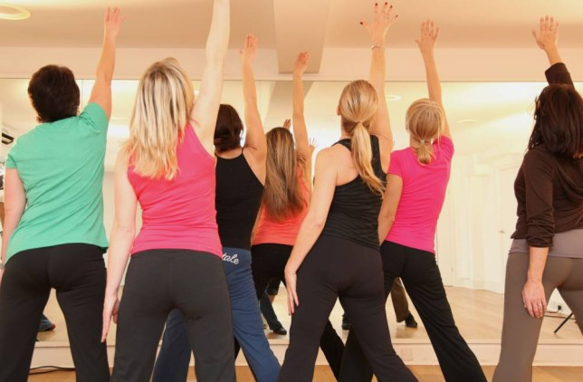 A group of ladies doing aerobics.  A dance class at lunchtime is a great way to burn fat and have fun at the same time.  BFGC0T