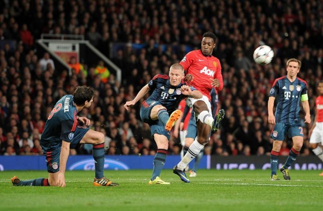 Bayern Munich's Bastian Schweinsteiger (left) and Manchester United's Danny Welbeck battle for the ball during the UEFA Champions League Quarter Final match Old Trafford, Manchester. PRESS ASSOCIATION Photo. Picture date: Tuesday April 1, 2014. See PA story SOCCER Man Utd. Photo credit should read: Martin Rickett/PA Wire
