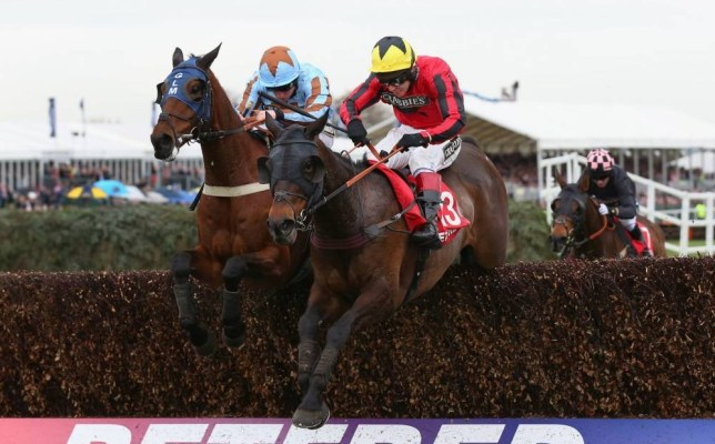 LIVERPOOL, ENGLAND - APRIL 05:  Duke of Lucca ridden by Richard Johnson jumps the last fence alongside Vino Griego ridden by Jamie Moore on their way to victory in the Betfred TV Handicap Chase at Aintree Racecourse on April 5, 2014 in Liverpool, England.  (Photo by Alex Livesey/Getty Images)