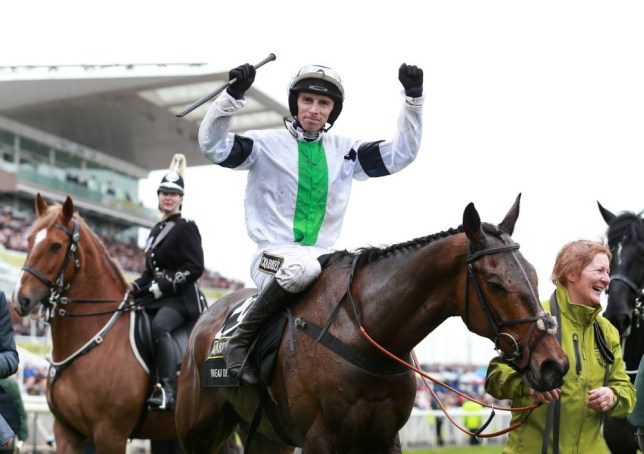 Leighton Aspell celebrates on Pineau De Re after winning The Crabbie's Grand National Steeple Chase during Grand National Day of the Crabbie's Grand National 2014 Festival at Aintree Racecourse, Liverpool. PRESS ASSOCIATION Photo. Picture date: Saturday April 5, 2014. See PA story RACING Aintree. Photo credit should read: David Davies/PA Wire