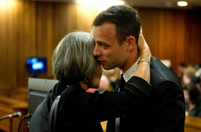 Comfort: Pistorius is hugged by his aunt, Lois, in court Picture: AP