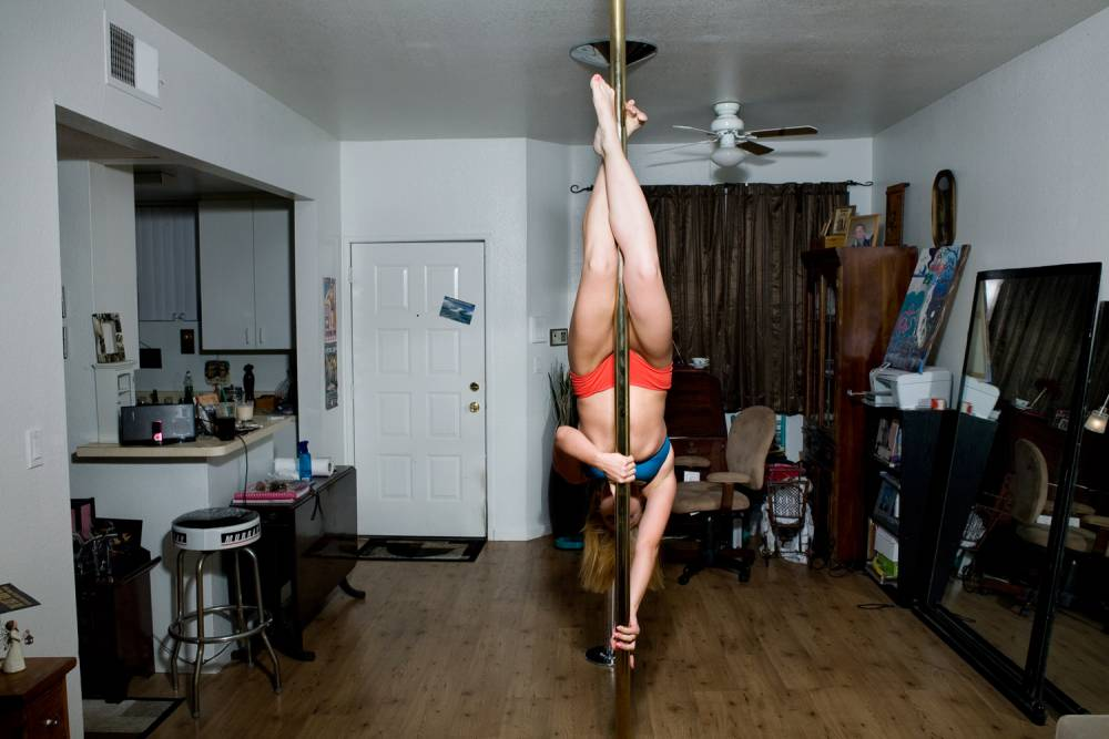 Photographer Tom Sanders has captured a series of impressive images showing Silicon Valley women working out on poles they've installed at home (Picture: Tom Sanders)