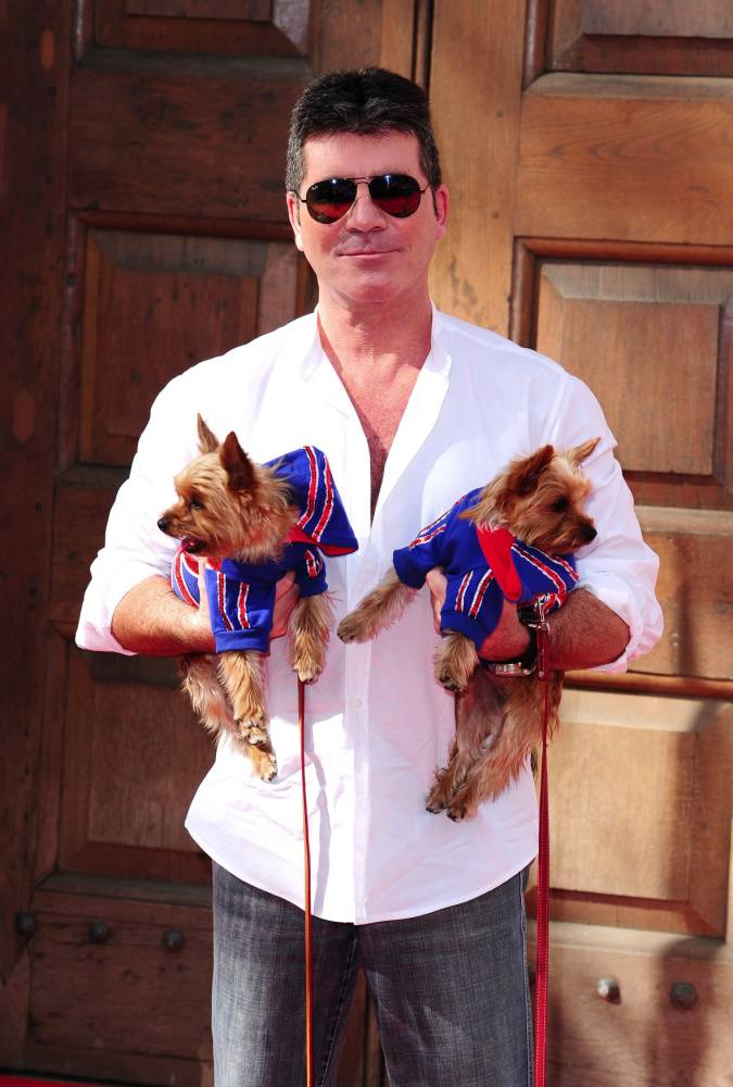 Simon Cowell with his dogs Squiddly and Diddly attending a press launch for Britain's Got Talent (Picture: PA)