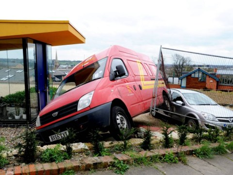 Royal Mail van rolls down hill, crashes into parked car and narrowly misses iconic house