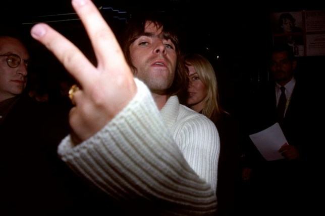 "LIAM GALLAGHER OF POP BAND ""OASIS"" WITH FIANCEE PATSY KENSIT (BEHIND) ARRIVE AT THE FISRT SCREENING OF THE FILM THE ROLLING STONES ROCK AND ROLL CIRCUS AT LONDON ASTORIA"