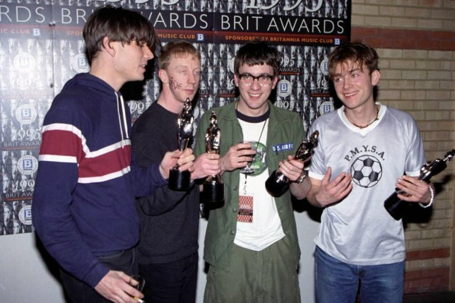 Blur celebrate with their four awards backstage. (l-r) Alex James, Dave Rowntree, Graham Coxon and Damon Albarn