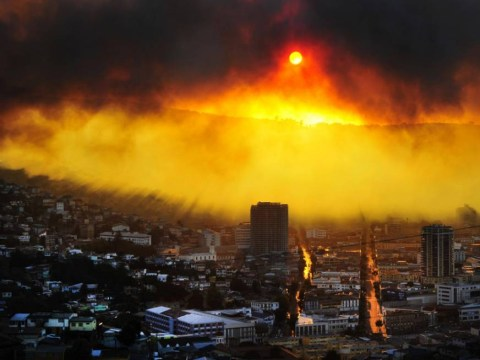Blazing fire in the sky: Sun shines through Chilean forest blaze that kills 16 and leaves 500 homeless