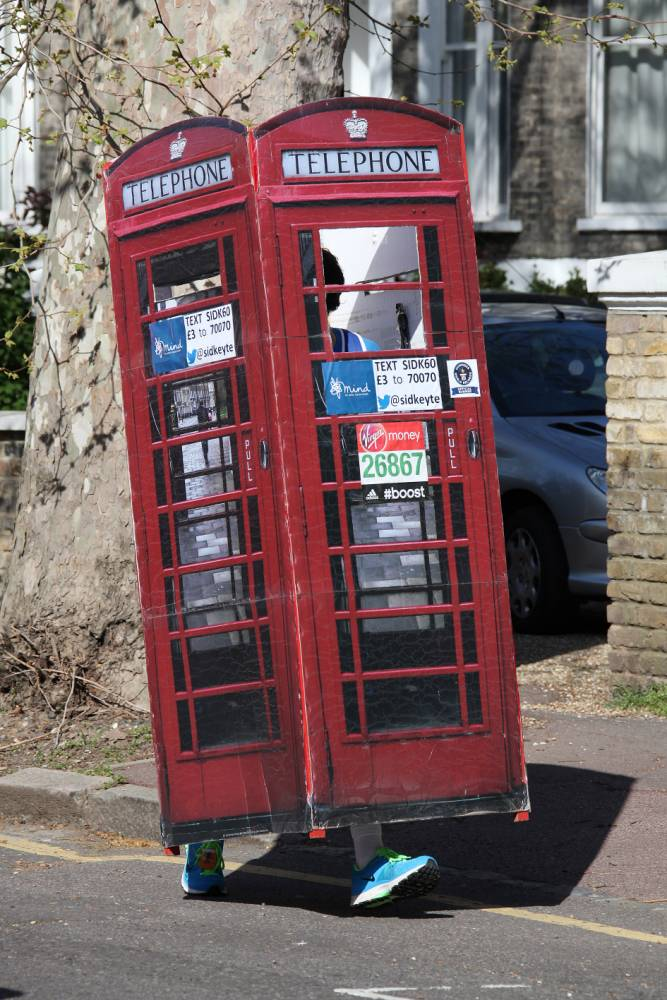 True calling: Sid Keyte sets record for fastest runner dressed as a phone box (Picture: Xposure)