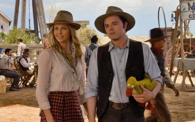 """Seth MacFarlane, right, and Charlize Theron in a scene from """"A Million Ways to Die in the West."""" (AP Photo/Universal Pictures)"""