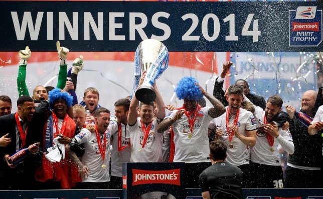 LONDON, ENGLAND - MARCH 30: Peterborough captain Tommy Rowe lifts the trophy after his team won the Johnstone's Paint Trophy Final between Chesterfield and Peterborough United at Wembley Stadium on March 30, 2014 in London, England. Ben Hoskins/Getty Images