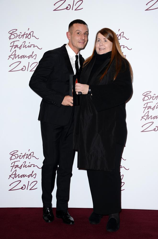 Louise Wilson, director of the MA fashion courst at Central Saint Martins and pictured here with designer Jonathan Saunders, died on Friday in her sleep (Picture: Ian Gavan/Getty Images)