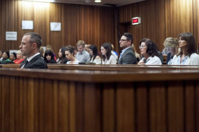 Broken: Oscar Pistorius looks on as his trial resumes (Picture: AFP)