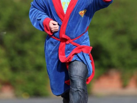 Superdad: Father catches burglar wearing nothing but a superman dressing gown