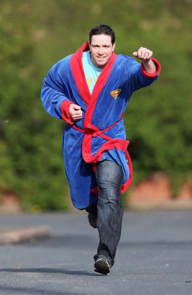 Picture shows Wayne Davies of Barnsley, South Yorkshire, who apprehended burglar Lee Arnott dressed in a superman design gown.  See Ross Parry copy RPYSUPERMAN :  A house burglar who was caught red-handed by a dad wearing nothing but a Superman dressing gown has been jailed.  Lee Arnott, 25, entered the home of dad Wayne Davies, 38, on April 7 but didn't account for the superheroic actions of the lecturer and his 17-year-old son Alex.  Alex gave chase after Arnott disturbed the family's dogs before brave Wayne, who was in bed at home in Barnsley, South Yorks., pulled on the nearest item of clothing available ñ a Superman dressing gown ñ and joined his son in apprehending the burglar. rossparry.co.uk / Tom Maddick