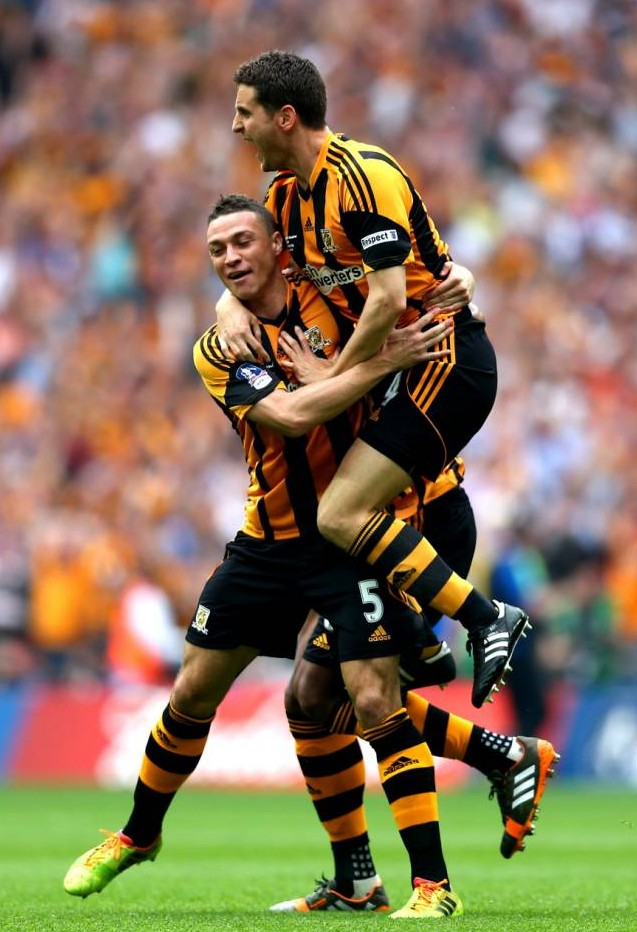 LONDON, ENGLAND - MAY 17:  James Chester of Hull City (5) celebrates with team mate Alex Bruce as he scores their first goal during the FA Cup with Budweiser Final match between Arsenal and Hull City at Wembley Stadium on May 17, 2014 in London, England.  (Photo by Clive Mason/Getty Images)