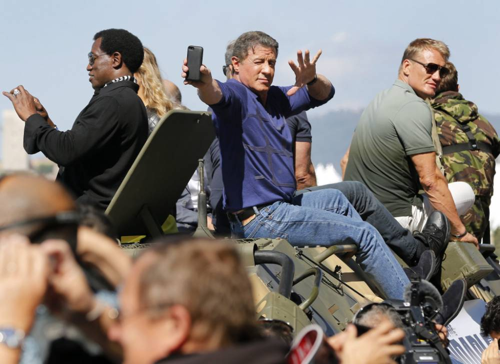 Sly Stallone, Arnie Schwarzenegger and co. ride tanks into Cannes as they reveal The Expendables 3 will be PG-13