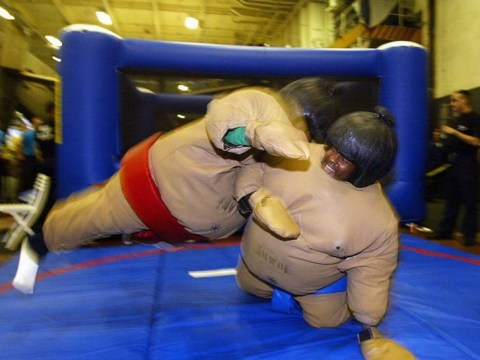 Man in sumo suit knocks himself out when colleagues bounces off inflatable torso and lands on his head