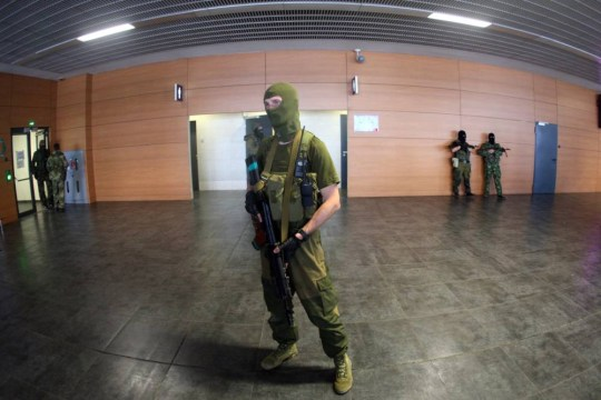 Pro-Russia militants take ther position in the international airport of the eastern Ukrainian city of Donetsk