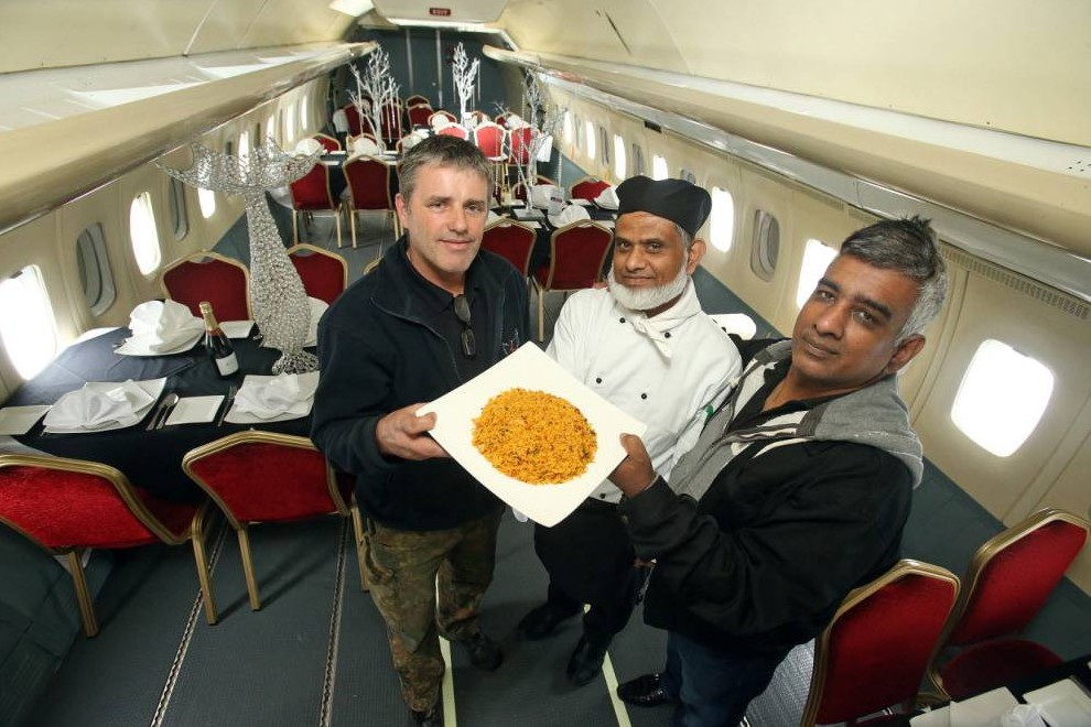 BPM MEDIA: Pictured L/R Jeff Anderson (GJD Services Ltd), Birmingham chef Mofur Miah and Mustafa Azim (Imperial Air Salvage) Picture taken on a Vickers VC10 at Bruntingthorpe Airfield.  ITíS the high-flying Indian restaurant which could really take off.Because pilot Mustafa Azim Aolad has teamed up with Birmingham chef Mofur Miah to launch the new curry venue ñ in a PLANE.Mustafa owns Imperial Air Salvage and has converted an old Boeing 737 into the 110-seater restaurant, currently parked up at Bruntingthorpe Airfield in Lutterworth, Leicestershire. The unique eatery will stage a summer charity event and, if successful, the entrepreneurs plan to launch other aeroplane restaurants across the Midlands, including in Birmingham.As a pilot, Mustafa made a living flying planes for celebrities including TV presenter Anthea Turner, rapper Snoop Dogg and DJ Jonny Vaughan. He also recently provided two old planes for Hollywood blockbuster Edge of Tomorrow, starring Tom Cruise.But now he and Mofuh, who owns the Amina Indian restaurant in Sutton Coldfield, have their eyes on the skies for their new charity event, which could lead to the new business venture.