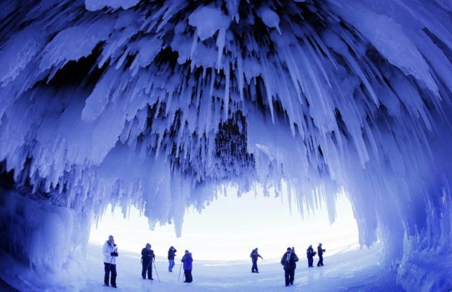 Mandatory Credit: Photo by MCT/REX (3622528a).. People tour the caves at Apostle Islands National Lakeshore in northern Wisconsin which are covered in natural ice sculptures brought on by arctic weather. Thousands brave the tough access to witness the fleeting natural beauty when it occurs... Ice Caves, Wisconsin, America - 02 Feb 2014.. ..
