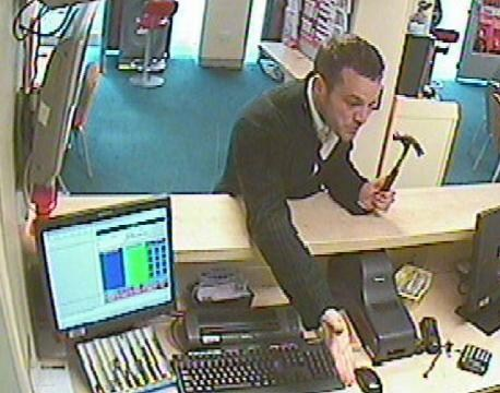 Robber armed with hammer raids betting shop