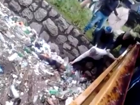Brave Bosnians save dog trapped from flooded river jammed with rubbish