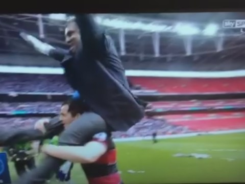 Joey Barton nearly drops QPR owner Tony Fernandes on his head during play-off celebrations