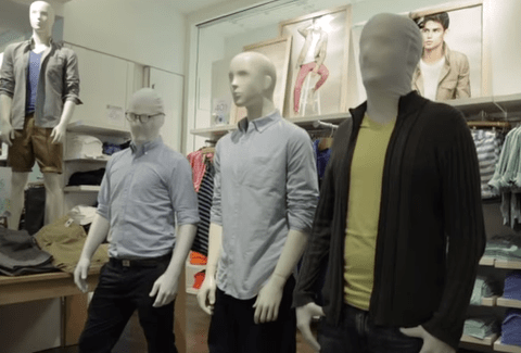 Flash mob handcuffed for playing silent statues in clothes shop after police fail to see funny side