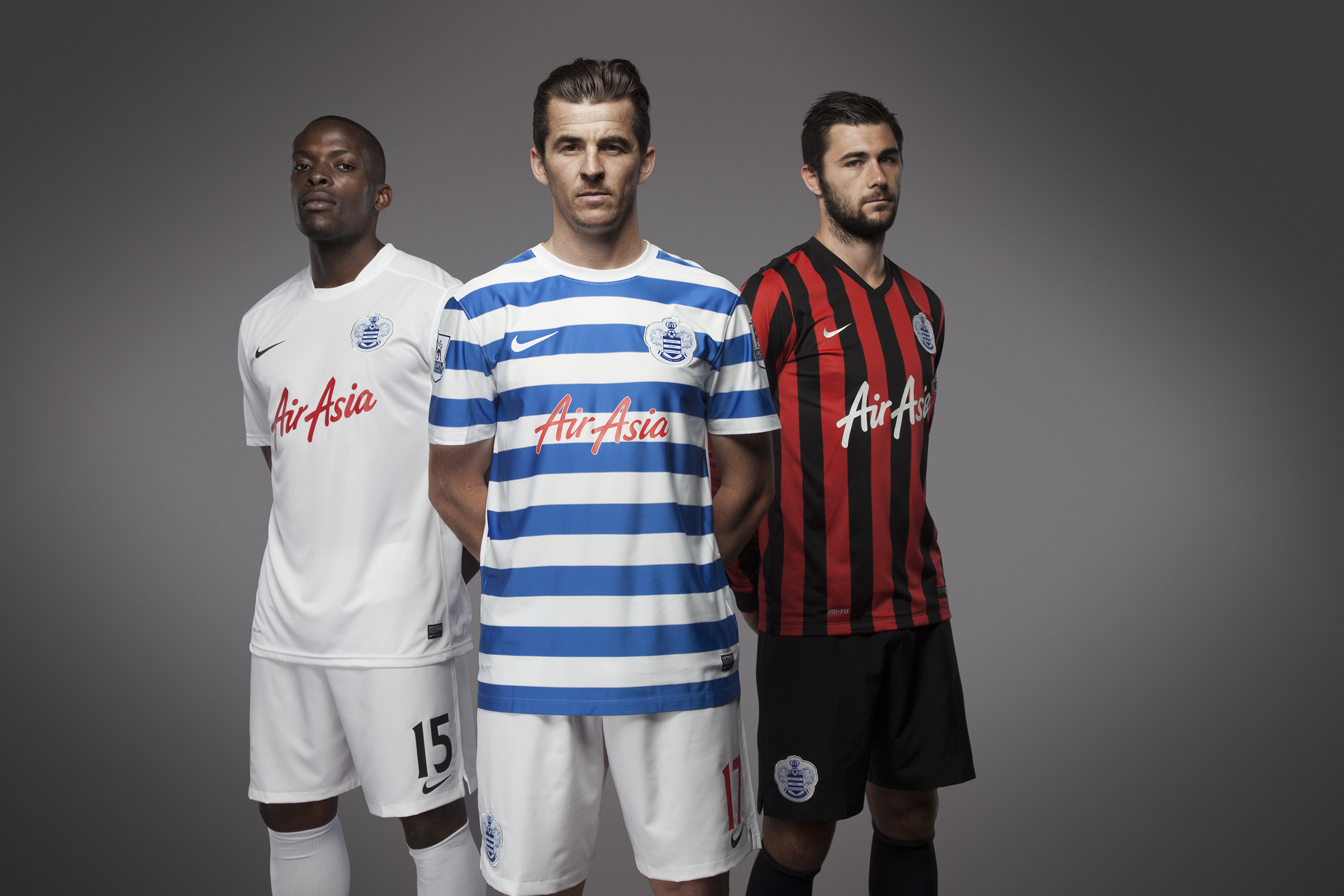 Joey Barton, centre, with Nedum Onouha, left, and Charlie Austin at the launch of the new QPR Nike kit (Picture: Nike)