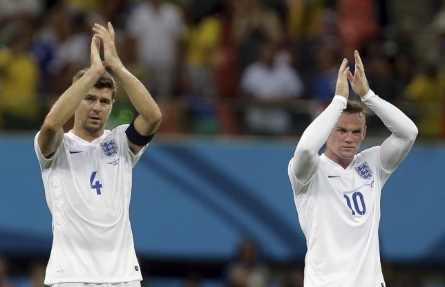 England's Steven Gerrard, left, and Wayne Rooney applaud spectators after the group D World Cup soccer match between England and Italy at the Arena da Amazonia in Manaus, Brazil, Saturday, June 14, 2014. Italy won the match 2-1. (AP Photo/Martin Mejia) AP Photo/Martin Mejia