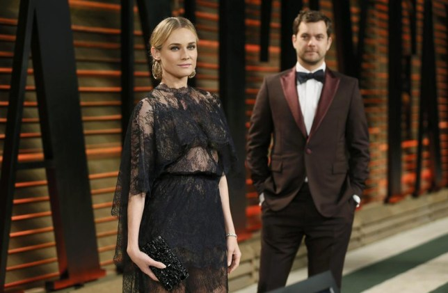 Actor Joshua Jackson and his partner, actress Diane Kruger arrive at the 2014 Vanity Fair Oscars Party in West Hollywood, California March 2, 2014. REUTERS/Danny Moloshok (UNITED STATES - Tags: ENTERTAINMENT)(OSCARS-PARTIES)