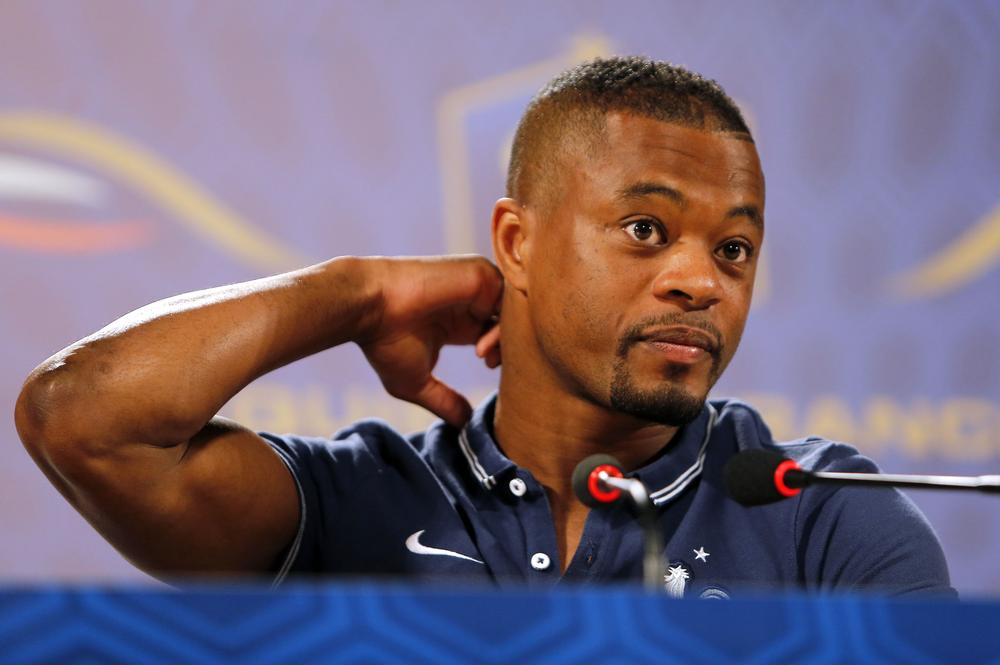 France's Patrice Evra attends a press conference at the Teatro Pedro II, in Ribeirao Preto, Brazil, Wednesday, June 18, 2014. France plays in group E of the 2014 Brazil soccer World Cup. (AP Photo/David Vincent) AP Photo/David Vincent