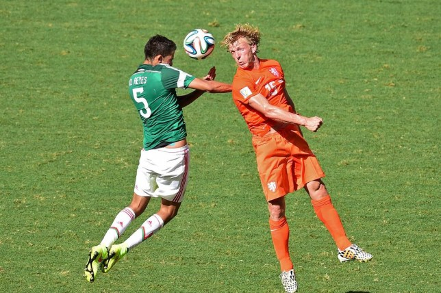 Netherlands' forward Dirk Kuyt (R) and Mexico's defender Diego Reyes vie for the ball during a Round of 16 football match between Netherlands and Mexico at Castelao Stadium in Fortaleza during the 2014 FIFA World Cup on June 29, 2014. AFP PHOTO / JAVIER SORIANO JAVIER SORIANO/AFP/Getty Images
