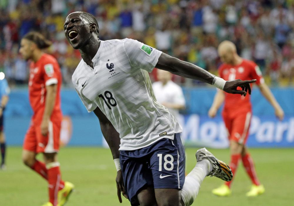 France's Moussa Sissoko celebrates after scoring his side's fifth goal during the group E World Cup soccer match between Switzerland and France at the Arena Fonte Nova in Salvador, Brazil, Friday, June 20, 2014. (AP Photo/Christophe Ena) AP Photo/Christophe Ena
