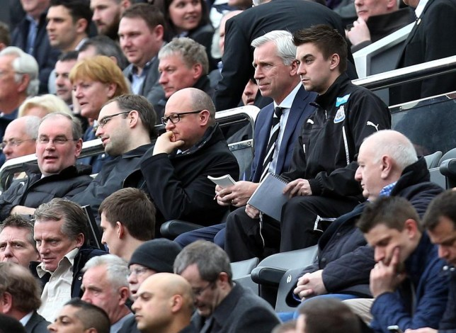 Newcastle United's manager Alan Pardew, top second right, looks on from the stands during their English Premier League soccer match against Manchester United at St James' Park, Newcastle, England, Saturday, April 5, 2014. (AP Photo/Scott Heppell) AP Photo/Scott Heppell