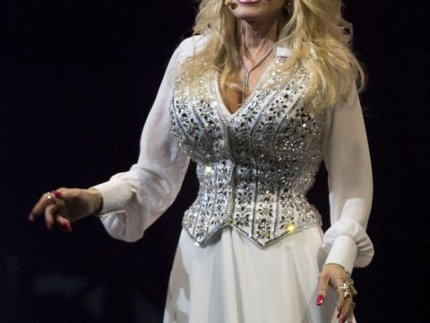 Dolly Parton celebrates 100 million album sales with surprise award at Glastonbury